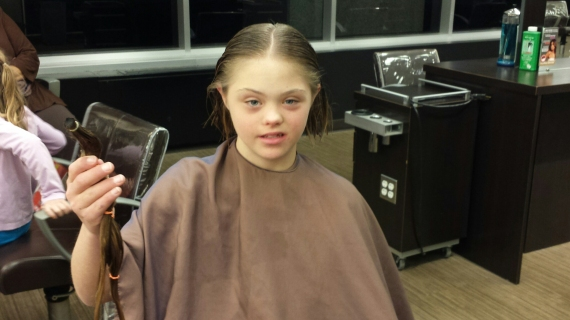 Abbey cutting her hair for Locks of Love